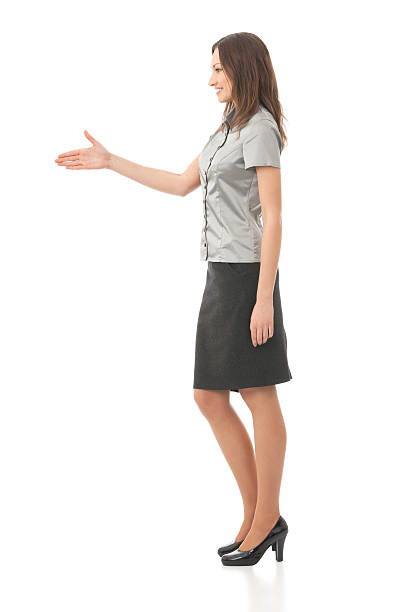 Full body portrait of businesswoman giving hand for handshake, isolated stock photo