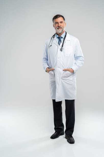 Full body portrait of happy smiling doctor, isolated on white background. Full body portrait of happy smiling doctor, isolated on white background lab coat stock pictures, royalty-free photos & images