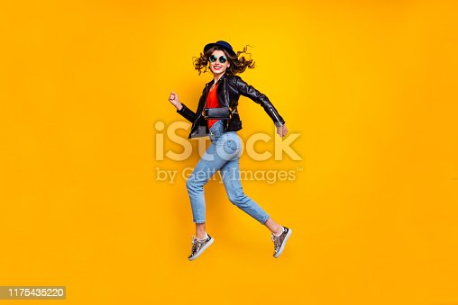 Full body profile side photo of cheerful dreamy jum run enjoy soring weekends, wear good look denim jeans isolated over yellow bright color background