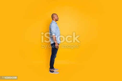 1163696387 istock photo Full body profile side photo of concentrated millennial listen look isolated over yellow background 1163694398