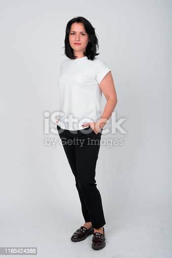 Studio shot of beautiful woman against white background