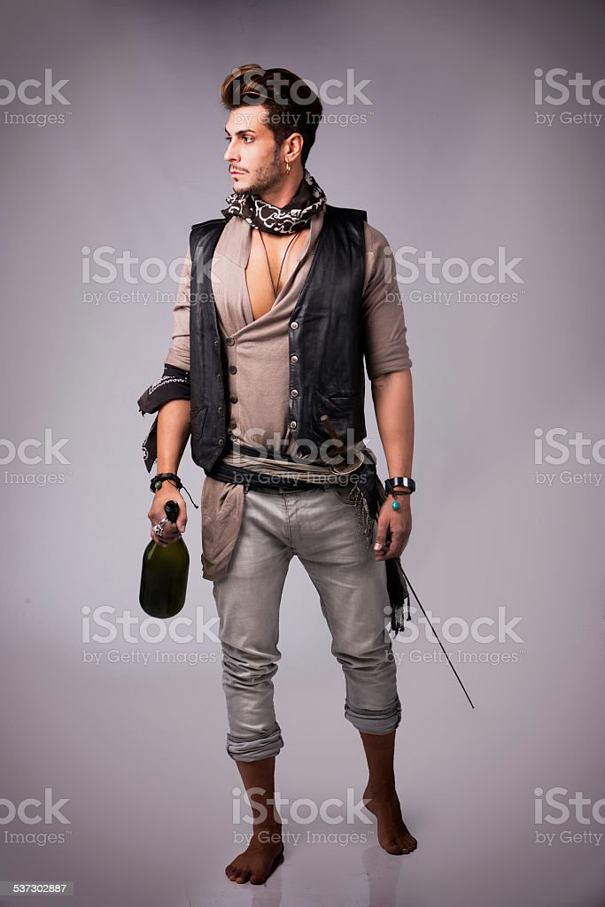 Full Body Shot of Good Looking Young Man in Pirate stock photo