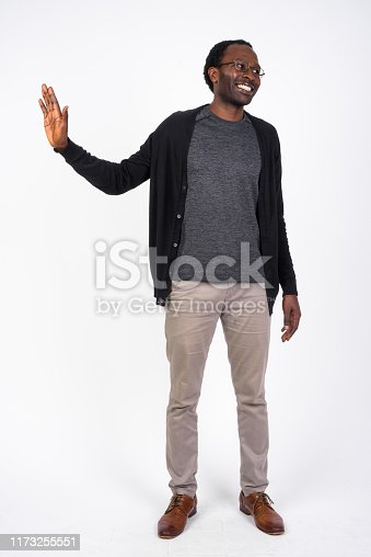 Studio shot of handsome African man against white background