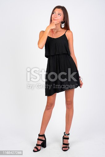 Studio shot of young beautiful woman against white background