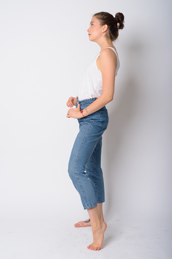 Full Body Shot Profile View Of Young Beautiful Woman Stock