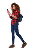 istock Full body young woman walking on isolated white background with mobile phone and bag 1035689416