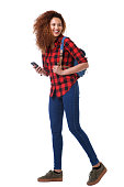istock Full body young woman walking on white background with mobile phone and bag 1035689420