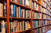 A variety of titles on the full shelves of a bookstore in San Francisco's Mission District.