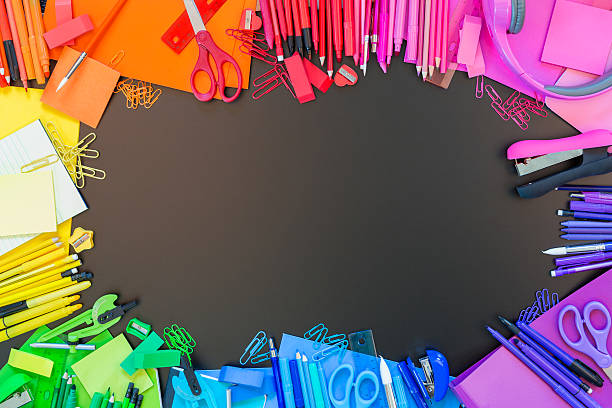 Full border of multi colored school supplies Full border of vibrant multi colored office supplies on chalkboard background. Border of colorful pens, pencils, markers, notebooks, paperclips, and other school supplies. Back to school theme. school supplies border stock pictures, royalty-free photos & images