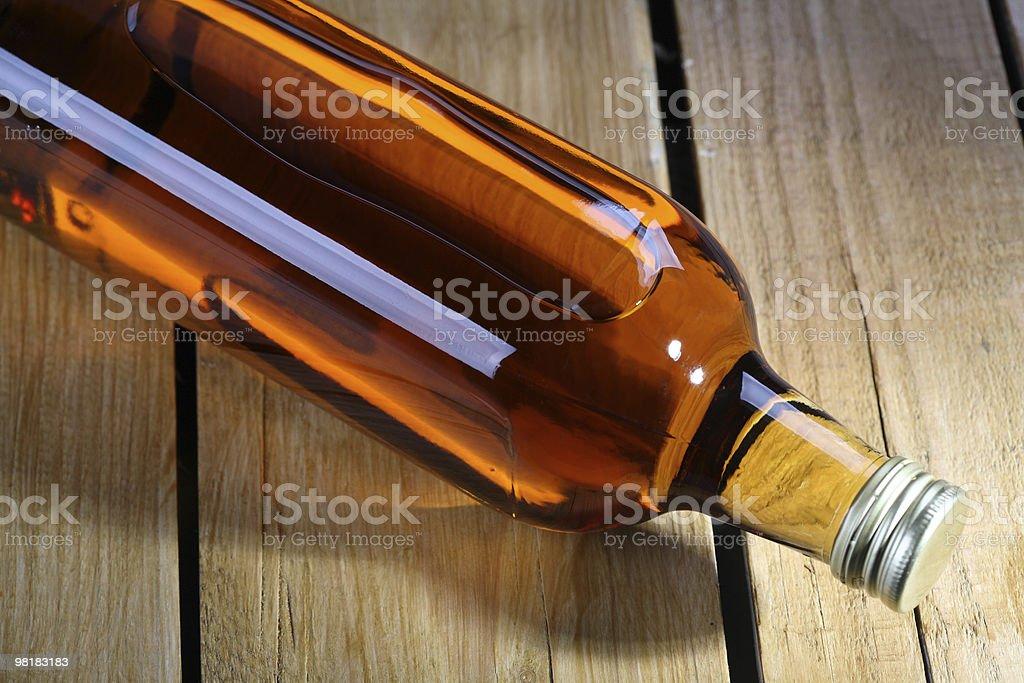 Full Bottle of Whisky Wood Style royalty-free stock photo