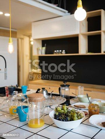 665910118istockphoto Full breakfast on Counter top in Kitchen 883680012