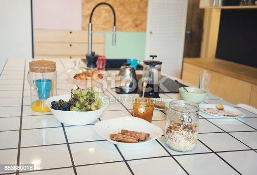 665910118istockphoto Full breakfast on Counter top in Kitchen 883680018