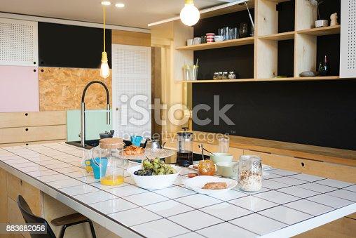 665910118istockphoto Full breakfast on Counter top in Kitchen 883682056