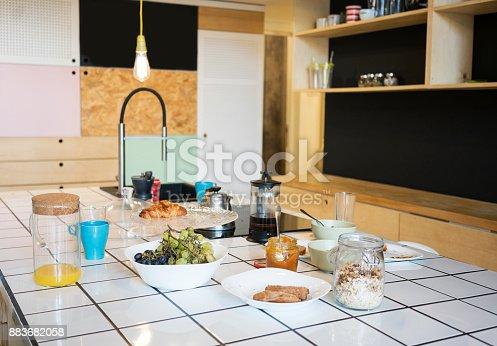 665910118istockphoto Full breakfast on Counter top in Kitchen 883682058