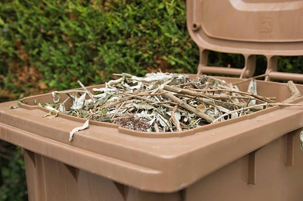 Full brown wheelie bin stock photo