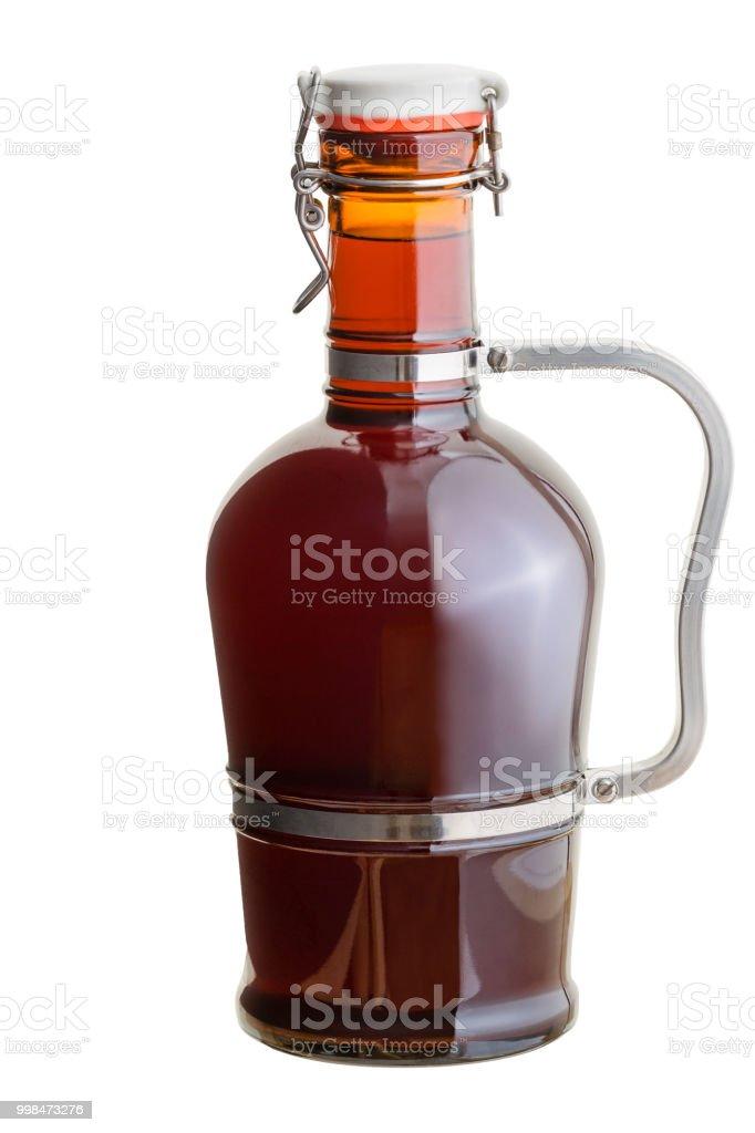Full capped amber glass German growler jug stock photo