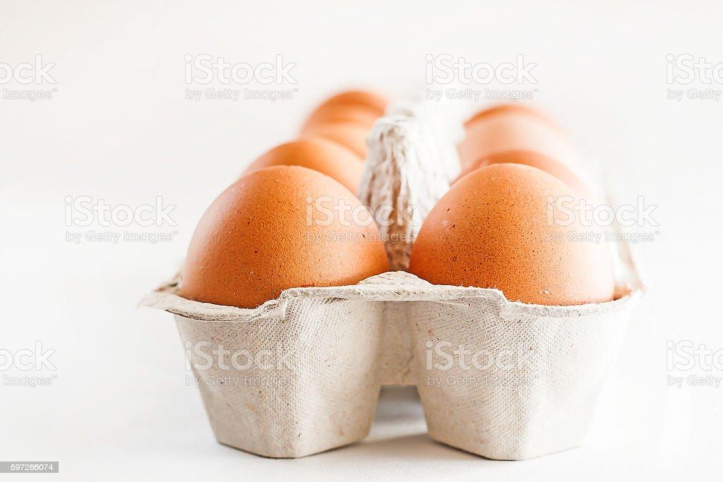 full carton of brown eggs on a white background Lizenzfreies stock-foto