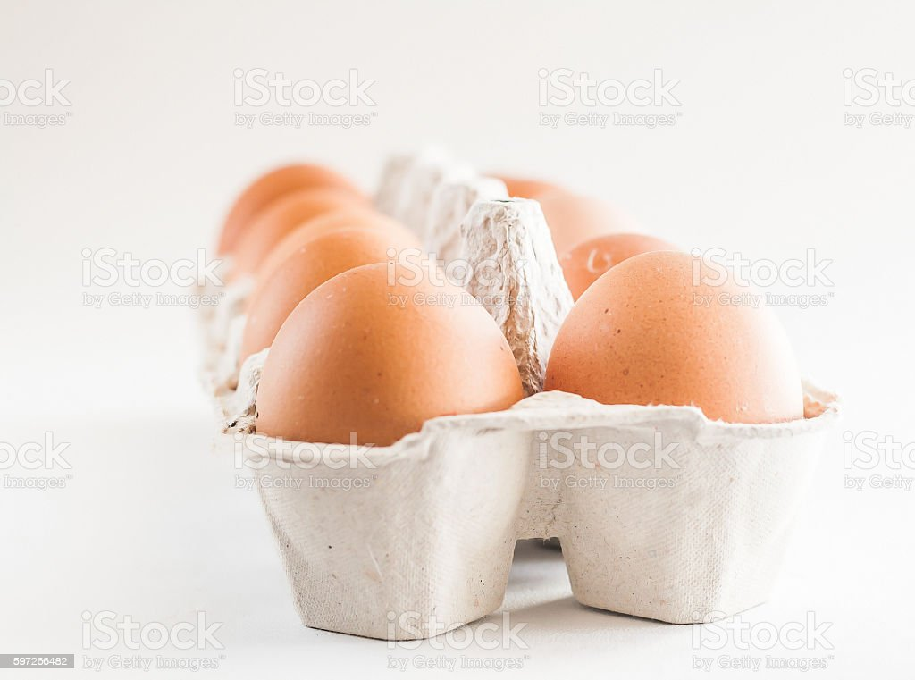 full carton of brown eggs on a white background royalty-free stock photo
