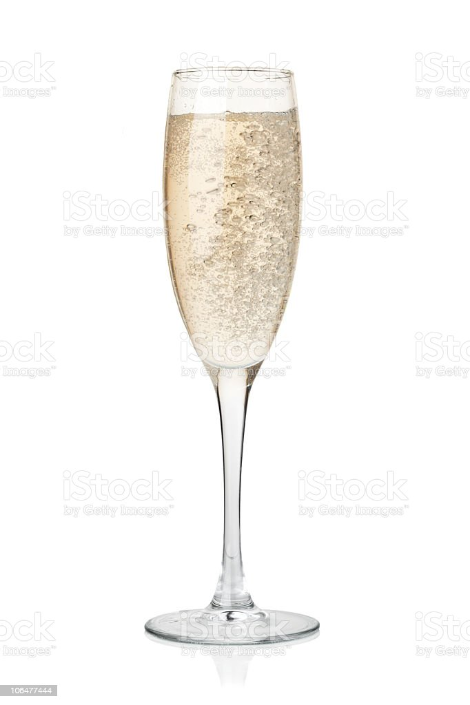 A full champagne glass on a white background royalty-free stock photo
