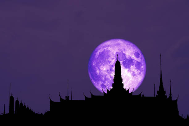 full cold blood moon back on silhouette buddhist temple in the night sky stock photo