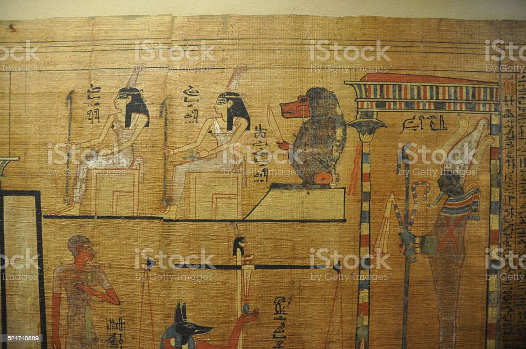 Full color Egyptian hieroglyphics on papyrus depicting Thoth and Osiris stock photo