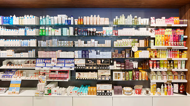 Full cosmetics shelves in a german pharmacy showing many products stock photo