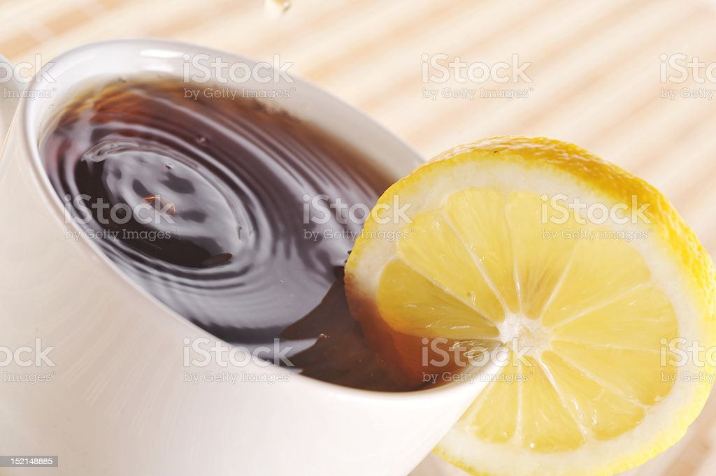 full cup of tea with lemon royalty-free stock photo