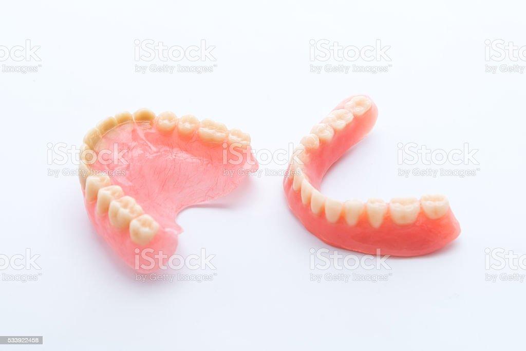 Full denture on white background stock photo