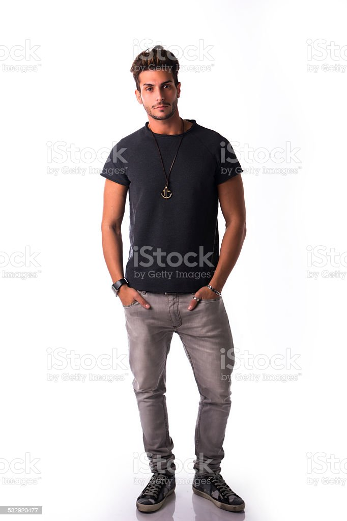 Full figure of handsome young man standing confident in casual stock photo
