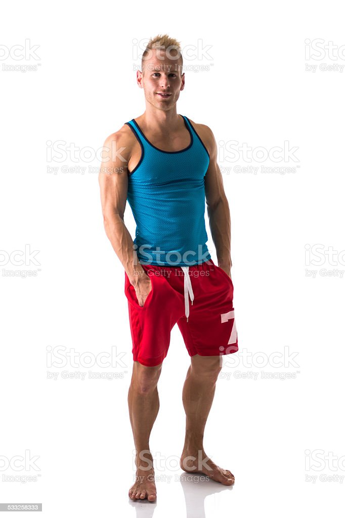 Full Figure Of Muscular Young Man Standing Confident Barefoot Smiling Royalty Free Stock