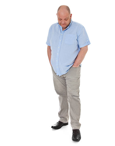 Full figured charismatic man looking down stock photo