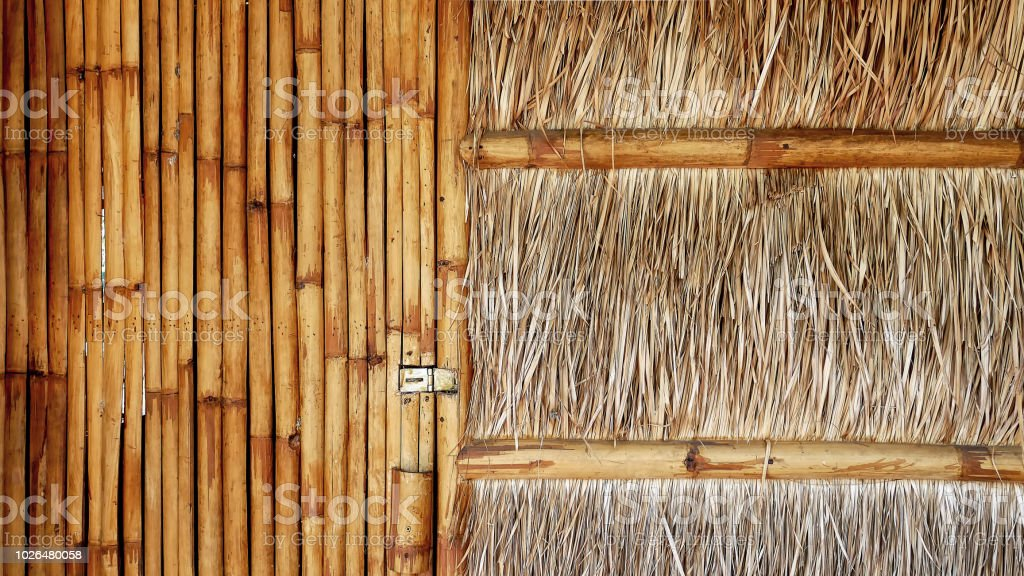 Full Frame Background of Front View of Traditional House with Bamboo Door and Thatched Wall stock photo