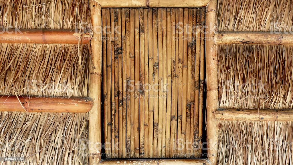 Full Frame Background of Front View of Traditional House with Bamboo Window and Thatched Wall stock photo