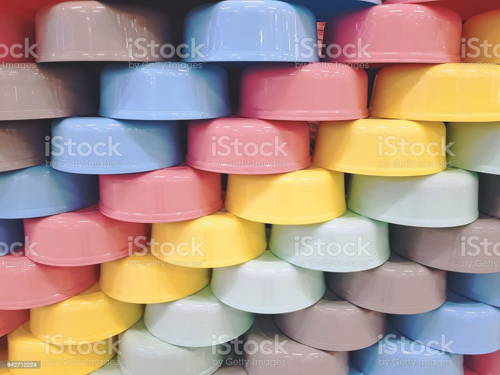 Full Frame Background of Staggered Colorful Plastic Bowls stock photo