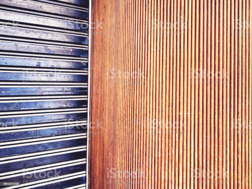 Full Frame Background of Steel Corrugated Door and Wooden Wall Texture - Royalty-free Architecture Stock Photo