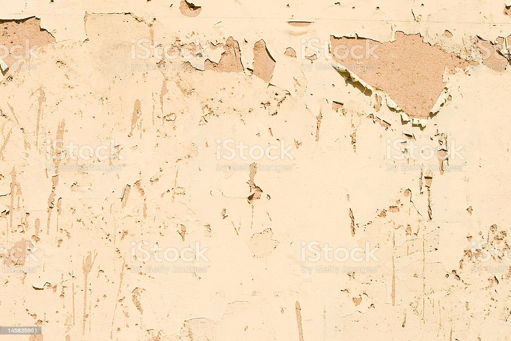 Full Frame Beige Paint Peeling Off Wall royalty-free stock photo