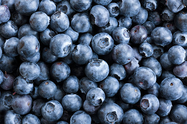 full frame close up background blueberries, large group of objects - blueberry stock pictures, royalty-free photos & images