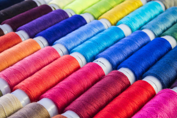 Full frame, colour sewing threads stock photo