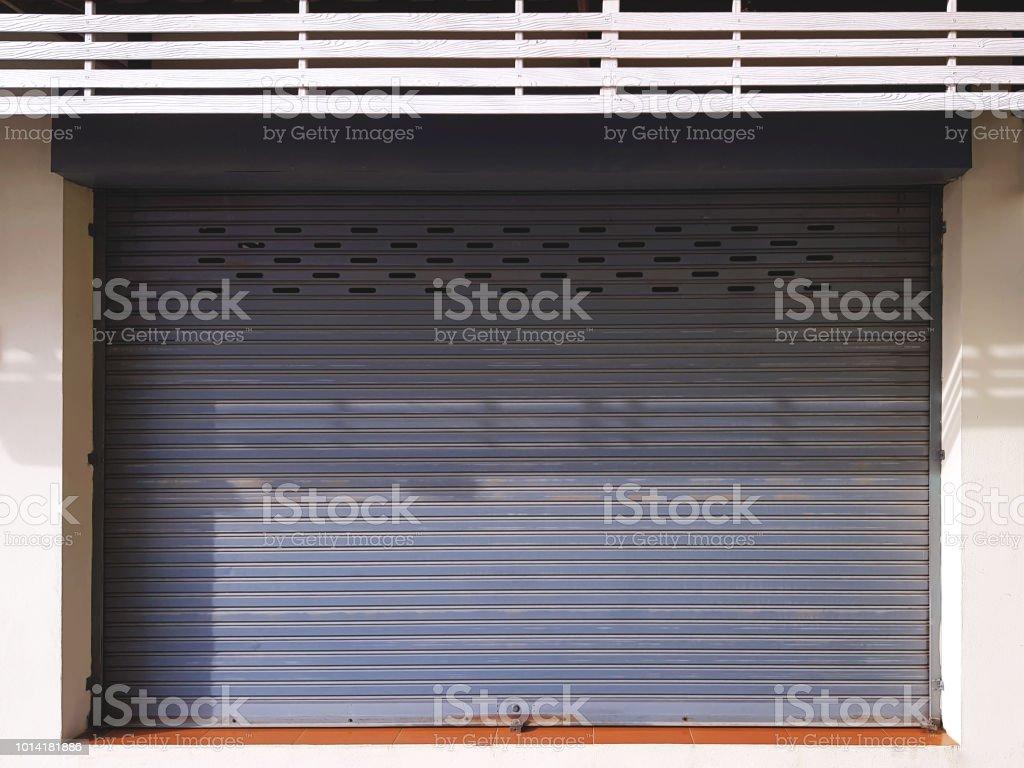 Close Corrugated Metal Door at Store Front