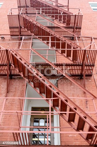 472923810 istock photo Full frame fire escape on a red brick building 472203466