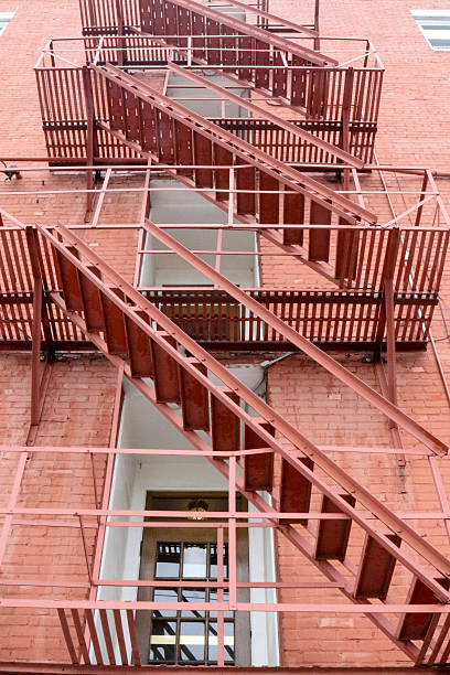 Full frame fire escape on a red brick building stock photo