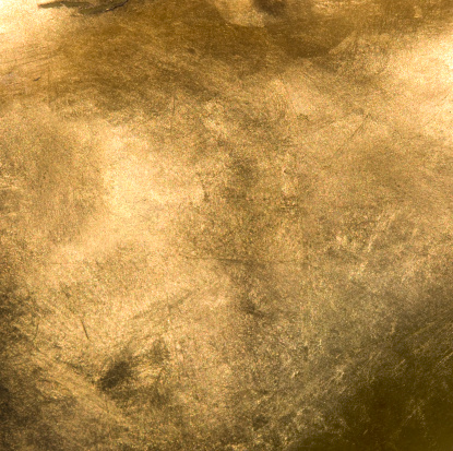 Full frame Gold background. The gold in the image is shiny and has a lot of texture and colors.