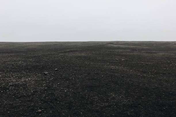 full frame image of black sand beach against cloudy sky in Solheimasandur, Iceland full frame image of black sand beach against cloudy sky in Solheimasandur, Iceland sólheimasandur stock pictures, royalty-free photos & images