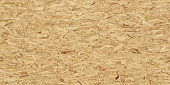 Full frame image of oriented strand board (OSB). High resolution seamless texture