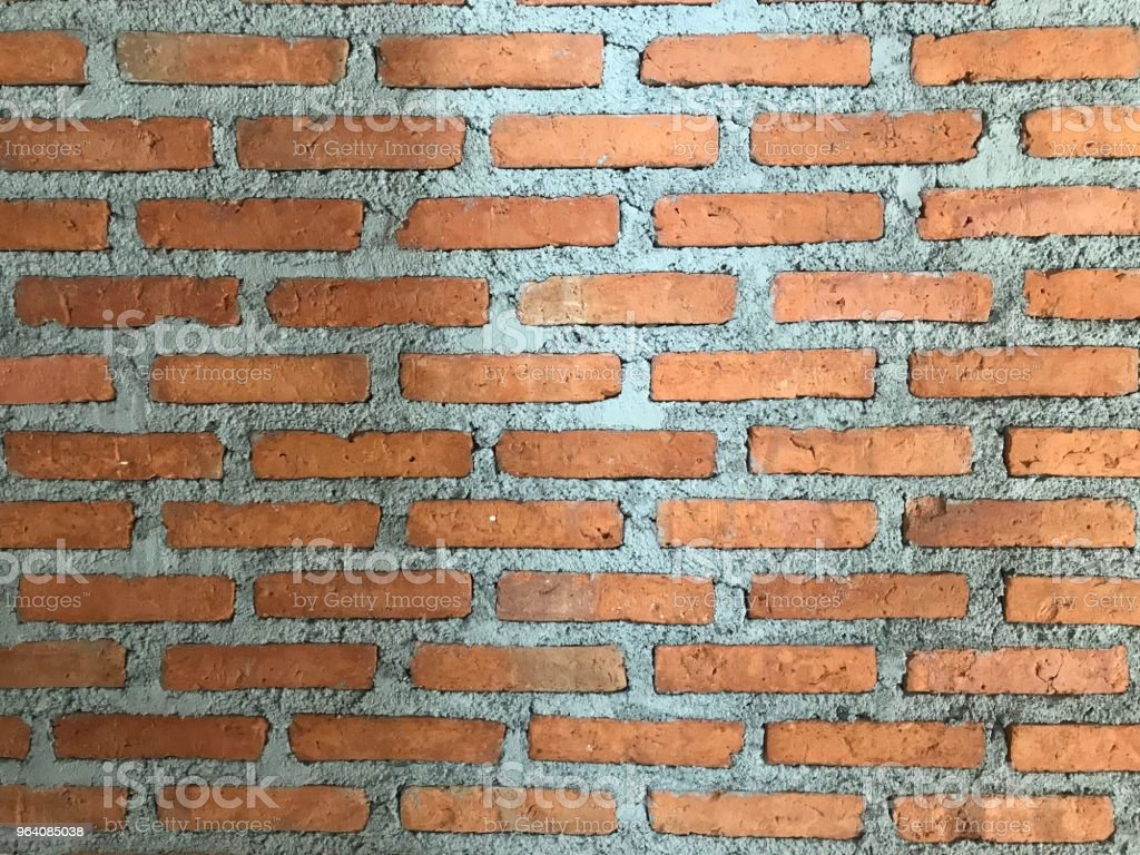 full frame of brick and cement wall in day light - Royalty-free Abstract Stock Photo