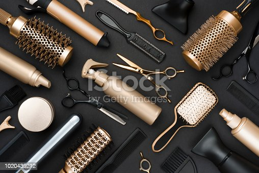 istock Full frame of professional hair dresser tools on black background 1020439212