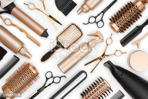 istock Full frame of professional hair dresser tools on white background 1024577076