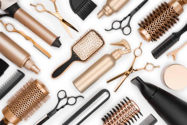 Full frame of professional hair dresser tools on white background stock photo
