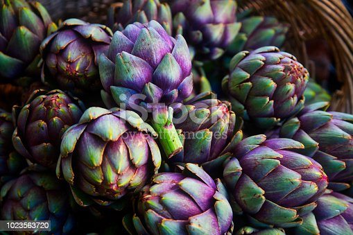 full frame of purple italian artichokes at the farmer's market