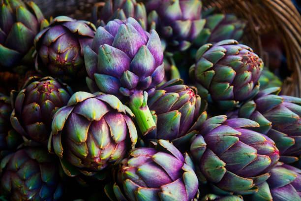 full frame of purple italian artichokes stock photo
